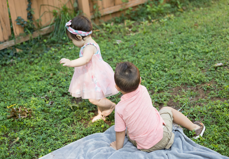 Boy and girl playing outside
