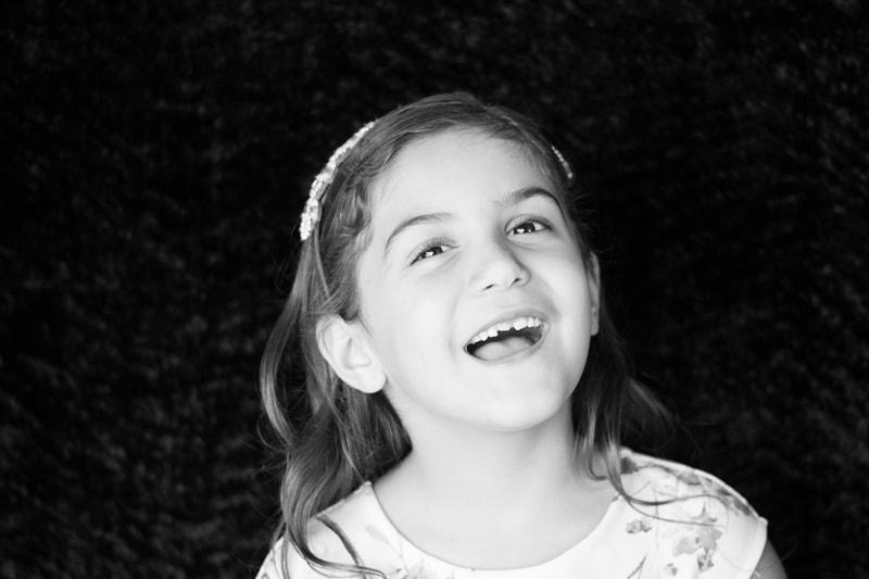 Black and white girl laughing, school photography